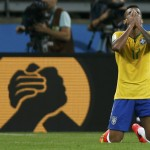 Brazil's Luiz Gustavo reacts after the 2014 World Cup semi-finals between Brazil and Germany at the Mineirao stadium
